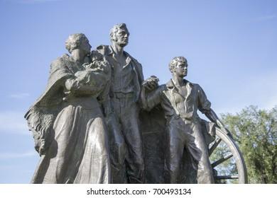 BISMARCK, NORTH DAKOTA - July, 20, 2017: Photo of the Pioneer Family statue located on the North Dakota Capital Grounds, Bismarck, North Dakota.