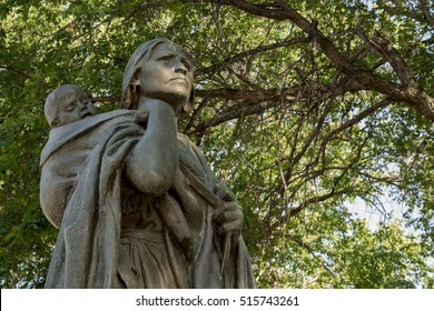 BISMARCK, NORTH DAKOTA - July, 24, 2015: Statue of Sacagawea and her son Jean-Baptiste Charbonneau, guide on the Lewis and Clark expedition, Bismarck, North Dakota