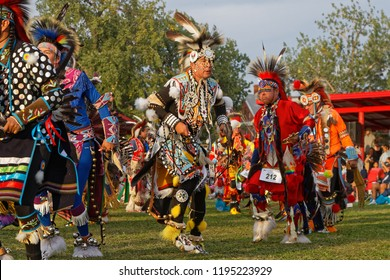 BISMARK, NORTH DAKOTA, September 8, 2018 : Grand Entry of the 49th annual United Tribes Pow Wow, one large outdoor event that gathers more than 900 dancers celebrating native american culture.
