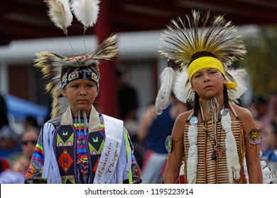 BISMARK, NORTH DAKOTA, September 9, 2018 : Sioux children at the 49th annual United Tribes Pow Wow, one large outdoor event that gathers more than 900 dancers celebrating native american culture.