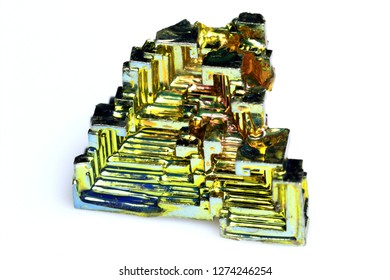 Bismuth crystal isolated in front of a white background