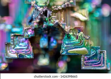 bismuth crystals close-up, metal, facets, color