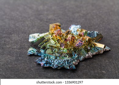 Bismuth crystals on a dark background. This is the most strongly diamagnetic element and also the heaviest that is not radioactive