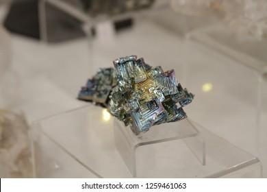 Bismuth irridecent rock gemston gem crystals on display