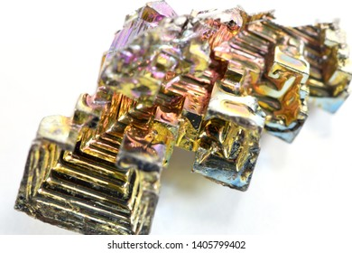 Bismuth Oxide Crystal closeup on white background