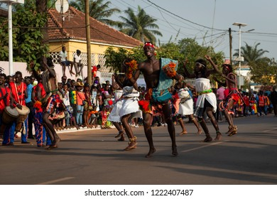 Bissau, Republic of Guinea-Bissau - February 12, 2018: Men and women wearing traditional clothing at a parade during the Carnival Celebrations in the city of Bisssau.