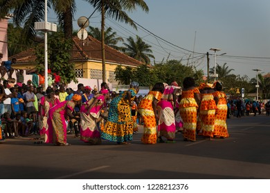 Bissau, Republic of Guinea-Bissau - February 12, 2018: Group of women wearing traditional clothing performing during the Carnival Celebrations in the city of Bisssau.