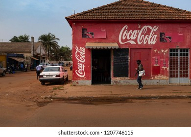 Bissau, Republic of Guinea-Bissau - February 5, 2018: Street scene in the city of Bissau with man passing in front of a restaurant, in Guinea-Bissau, West Africa