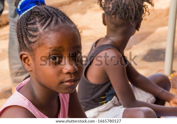 Bissau, Republic of Guinea-Bissau - February 6, 2018: young african girl portrait in Bissau, Guinea-Bissau