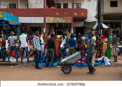 Bissau, Republic of Guinea-Bissau - January 28, 2018: Street scene in the city of Bissau with people at the Bandim Market, in Guinea-Bissau, West Africa