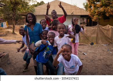 Bissau, Republic of Guinea-Bissau - January 29, 2018: Portrait of a group of children playing and smiling, at the Bissaque neighborhood in the city of Bissau, Guinea Bissau.