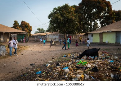 Bissau, Republic of Guinea-Bissau - January 29, 2018: Group of children playing in a dirty street at the Bissaque neighborhood in the city of Bissau, Guinea Bissau.