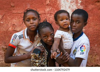 Bissau, Republic of Guinea-Bissau - January 31, 2018: Group of children outside their home at the Cupelon de Cima neighborhood in the city of Bissau, Guinea Bissau.