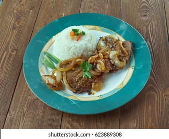 Bistec de Palomilla -  Cuban dish consisting of beef round steak marinated in garlic, lime juice, salt and pepper then pan-fried