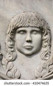 BISTRITA, ROMANIA, statue in cemetery,  BABY  FACE   SCULPTURE