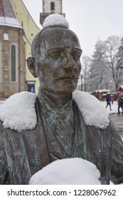 BISTRITA, TRANSYLVANIA/ROMANIA - SEPTEMBER 17 : Bronze statue of the photographer Alexandru Rosu in Bistrita Transylvania Romania , 2018