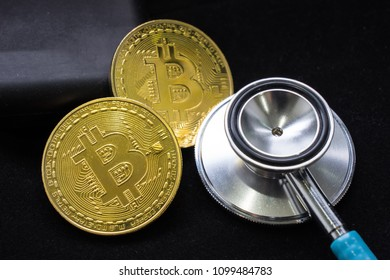 Bit coin close up with a check up