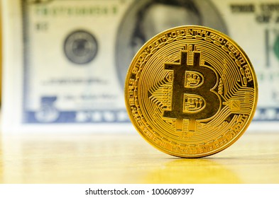 Bit coin with a dollar banknote background.