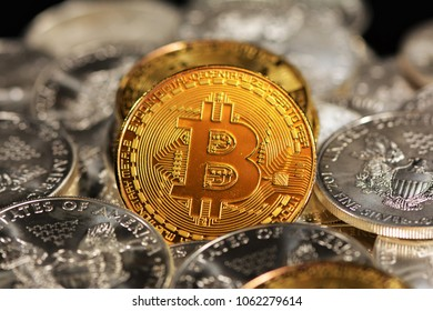 Bit coins with Diamonds and Silver Dollars - Shutterstock ID 1062279614