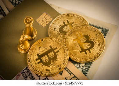 Bit coins and gold king chess on notes bank  for saving.