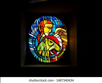 BITBURG, GERMANY - OCTOBER 23, 2012: Beautiful circular stained glass window in Our Lady Church or Liebfrauenkirche in Bitburg, Rhineland-Palatinate