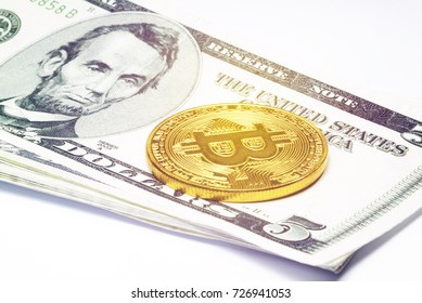 Bitcion Gold placed in dollar banknotes.