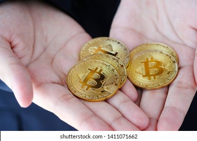 Bitcions in businessman hand, cryptocurrency and blockchain concept, business finance and technology