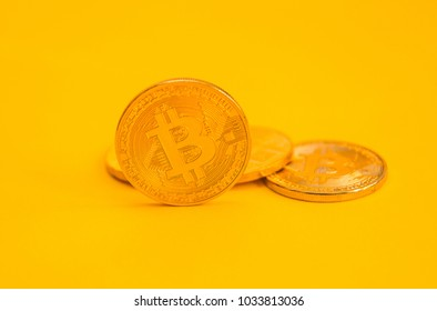 Bitcoi coin. Bitcoin. crypto currency. yellow background. isolated