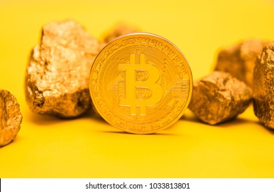 Bitcoi coin. Bitcoin. crypto currency. yellow background. isolated. pieces of gold. nuggets of gold