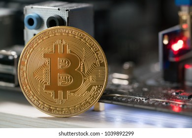 bitcoin against the background of the motherboard in the rack for the crypto currency mining