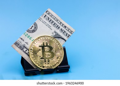 Bitcoin and American bank note on blue background