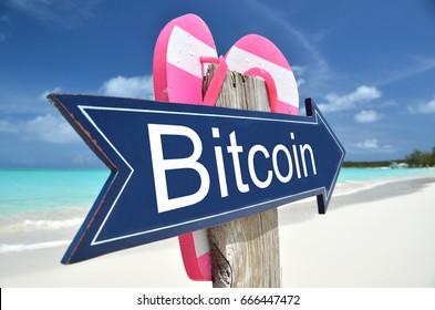 BITCOIN arrow on the beach