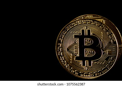 Bitcoin in black background / Bitcoin is a cryptocurrency and worldwide payment system. It is the first decentralized digital currency, as the system works without a central bank