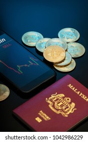 bitcoin with blue background technology withsmartphone and Malaysian passport
