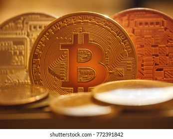Bitcoin BTC coin surrounded by real money, macro closeup. Description: Bitcoin BTC coin macro closeup.