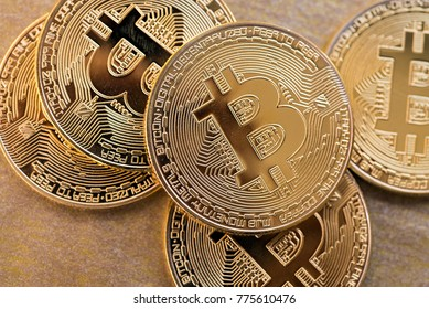 Bitcoin BTC concept. Golden Bitcoin coins as symbol of electronic virtual money