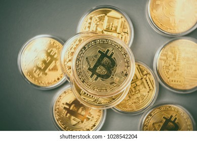 Bitcoin (BTC). Crypto currency. Macro shot of golden coins isolated on gray background. Blockchain technology, bitcoin mining concept.