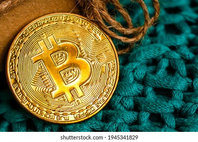Bitcoin BTC cryptocurrency and Christmas gift box, BTC golden coin as symbol of electronic virtual money for web banking and international network payment