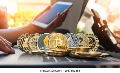 Bitcoin BTC cryptocurrency coin with altcoin digital crypto currency tokens, ETC Ethereum, ADA Cardano, LTC Litecoin, IOTA Miota,  ZEC Zcash for defi decentralized financial banking p2p global market