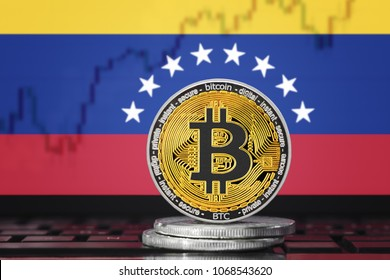 BITCOIN (BTC) cryptocurrency; coin bitcoin on the background of the flag of Venezuela