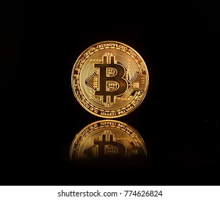 Bitcoin BTC the new virtual internet Cryptocurrency isolated on black background. Concept of future currency.