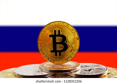 Bitcoin BTC on stack of cryptocurrencies with Russia flag in background. The cryptocurrency coin is golden and in focus