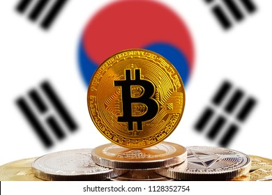 Bitcoin BTC on stack of cryptocurrencies with South Korea flag in background. The cryptocurrency coin is golden and in focus