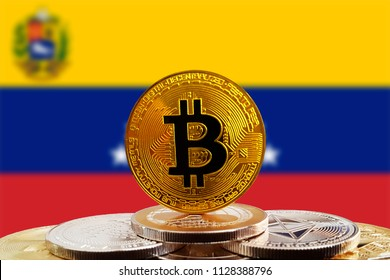 Bitcoin BTC on stack of cryptocurrencies with Venezuela flag in background. The cryptocurrency coin is golden and in focus
