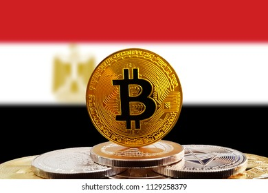 Bitcoin BTC on stack of cryptocurrencies with Egypt flag in background. The cryptocurrency coin is golden and in focus