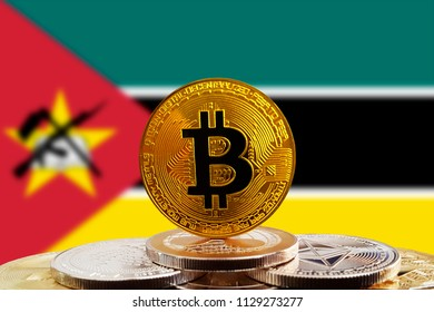 Bitcoin BTC on stack of cryptocurrencies with Mozambique flag in background. The cryptocurrency coin is golden and in focus