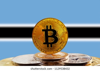 Bitcoin BTC on stack of cryptocurrencies with Botswana flag in background. The cryptocurrency coin is golden and in focus