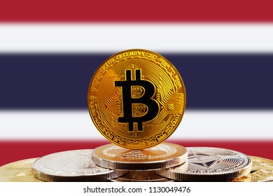Bitcoin BTC on stack of cryptocurrencies with Thailand flag in background. The cryptocurrency coin is golden and in focus
