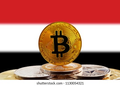 Bitcoin BTC on stack of cryptocurrencies with Yemen flag in background. The cryptocurrency coin is golden and in focus