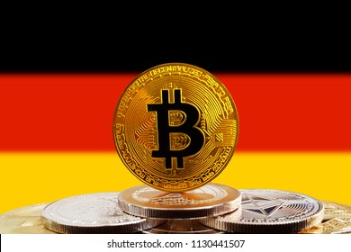 Bitcoin BTC on stack of cryptocurrencies with Germany flag in background. The cryptocurrency coin is golden and in focus